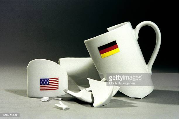 Broken mug with national emblems of Germany and the United States Symbolic picture Broken friendship between Germany and the United States of America