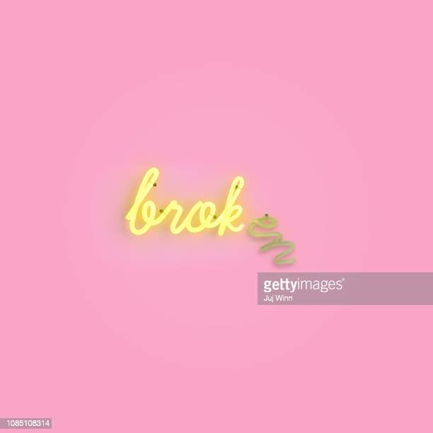 broken neon sign - neon letters stock photos and pictures