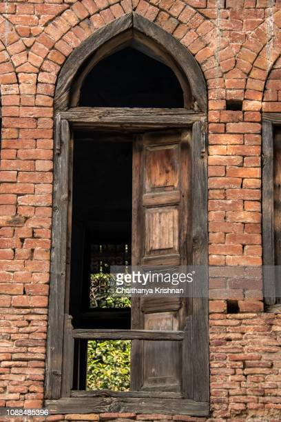 a broken old windows inside a park in jallian walla bagh memorial place - amritsar stock pictures, royalty-free photos & images