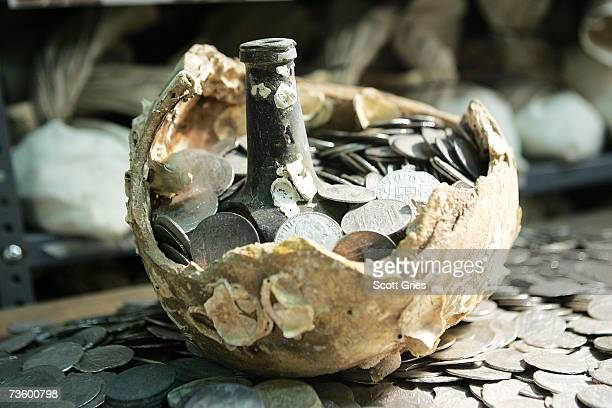 A broken olive jar with treasure coins The Franklin Mint's collection of treasure recovered from the sunken spanish ship El Cazador is seen among...