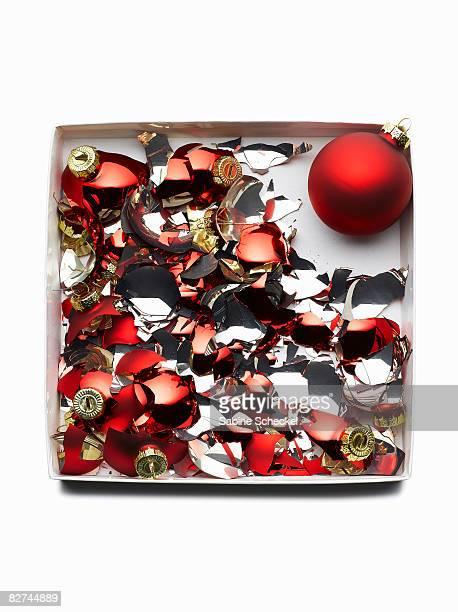 broken ornaments in box