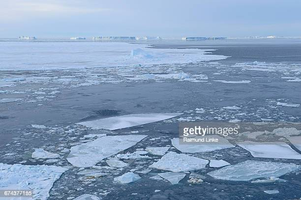 broken pack ice with ice floes and iceberg - weddell sea stock photos and pictures