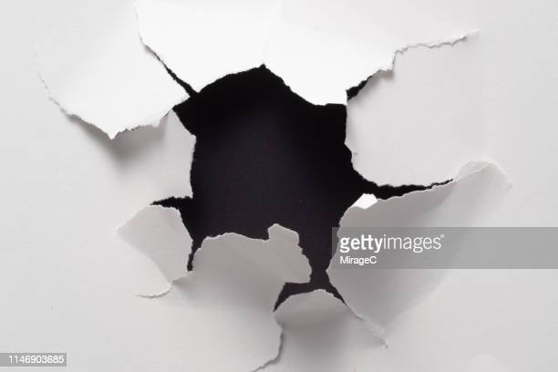 broken paper hole - hole stock pictures, royalty-free photos & images