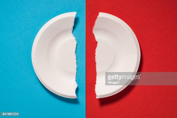 a broken paper plate - paper plate stock photos and pictures
