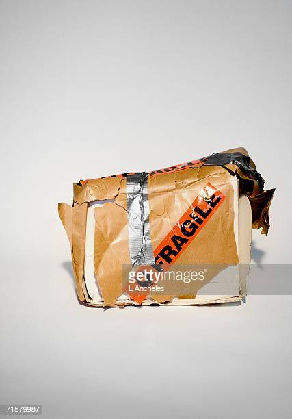 a broken parcel. - fragility stock pictures, royalty-free photos & images