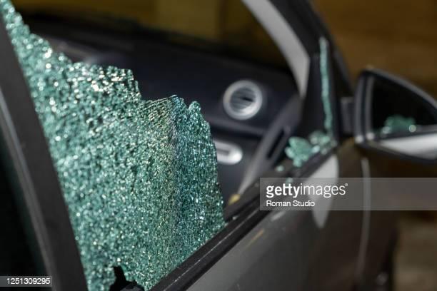 broken passenger window, car theft in the underground parking. - 公共物破壊 ストックフォトと画像