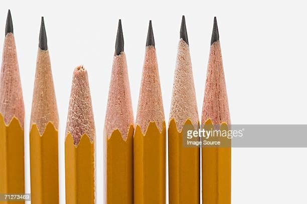 Broken pencil amongst sharp pencils