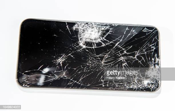 broken phone on white background - shattered glass stock pictures, royalty-free photos & images