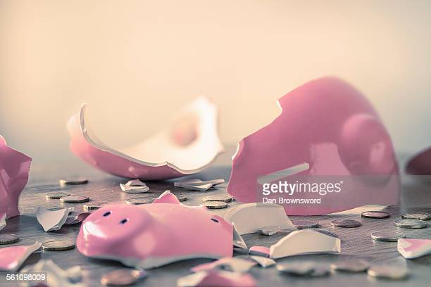 broken piggy bank and coins - piggy bank stock photos and pictures