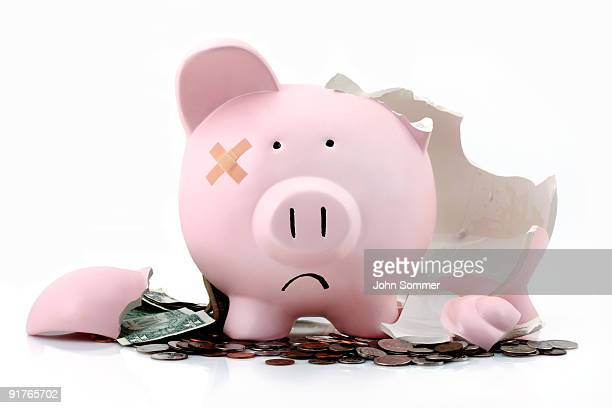 broken piggy bank - negative emotion stock pictures, royalty-free photos & images