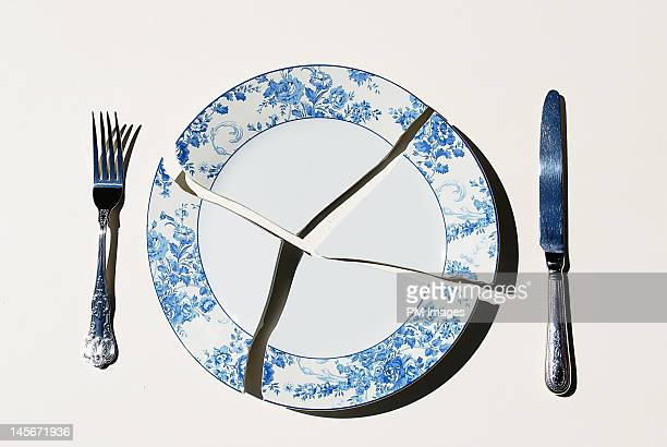 broken plate - crockery stock pictures, royalty-free photos & images
