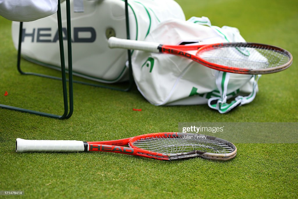A broken racquet belonging to Thiemo De Bakker of Netherlands rests on the grass next to his chair during his Gentlemen's Singles first round match against James Blake of the United States of America on day two of the Wimbledon Lawn Tennis Championships at the All England Lawn Tennis and Croquet Club on June 25, 2013 in London, England.