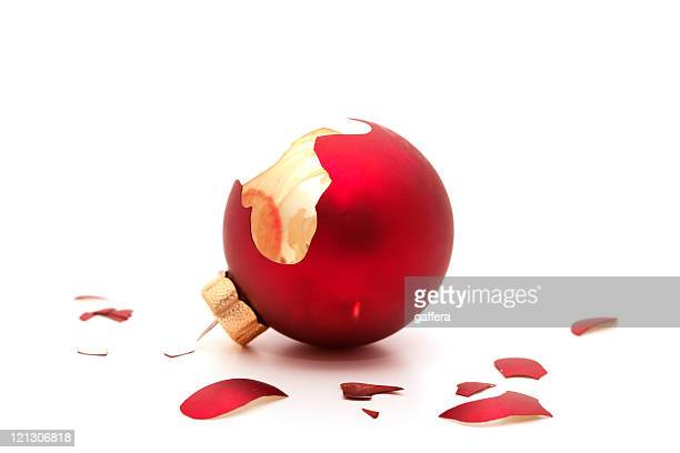 Broken red ornament on a white background