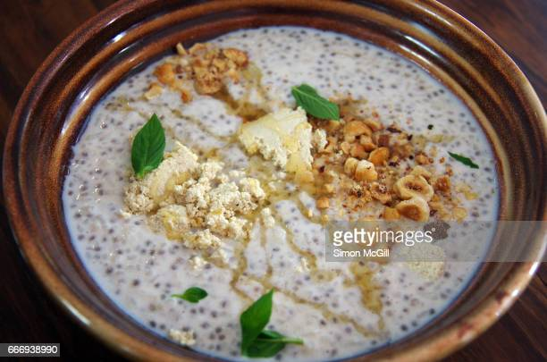 Broken rice pudding served cold with chia, cinnamon, honey, hazelnuts, halva