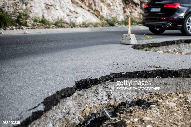 broken road - pothole stock photos and pictures
