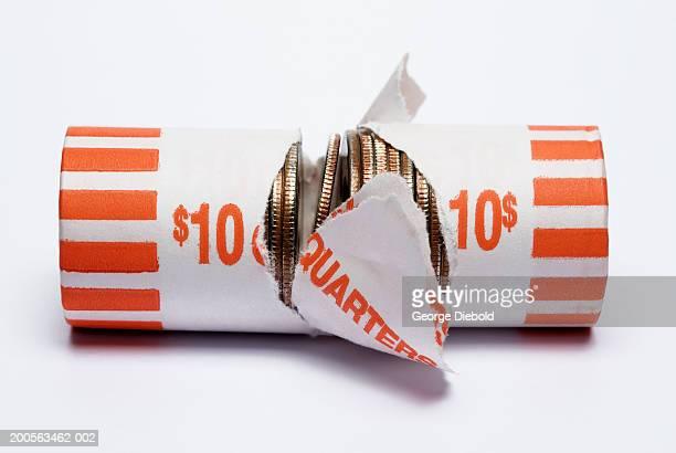 Broken roll of quarter coins on white background
