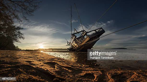A broken ship in  sunrise on  Phuket