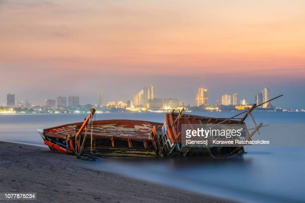 a broken ship in the sunset - sunken stock pictures, royalty-free photos & images