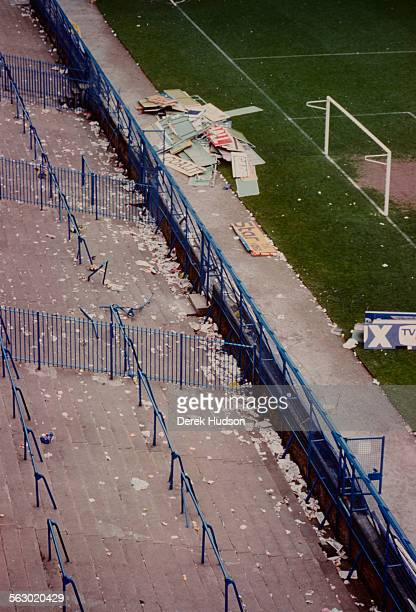 Broken signs and debris at Hillsborough Stadium the day after the stampede which resulted in the deaths of 96 people Sheffield 16th April 1989