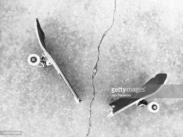broken skateboard on a sidewalk crack. - image stock pictures, royalty-free photos & images