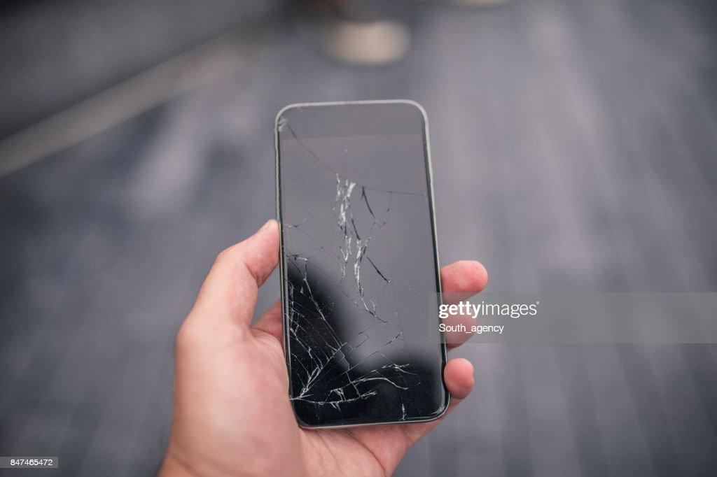 Broken smart phone : Stock Photo