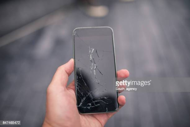 broken smart phone - broken stock pictures, royalty-free photos & images