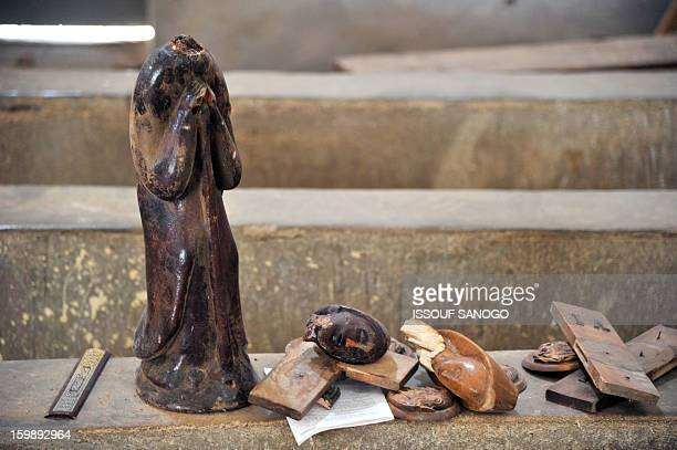 Broken statue of Virgin Mary is left on the ground of a Catholic church in Diabaly, on January 22, 2013. The EU executive today announced 20 million...