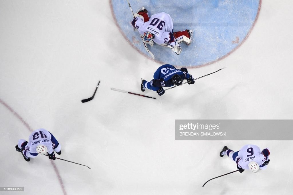 A broken stick is seen on the ice in the men's preliminary round ice hockey match between Finland and Norway during the Pyeongchang 2018 Winter Olympic Games at the Gangneung Hockey Centre in Gangneung on February 16, 2018. / AFP PHOTO / Brendan SMIALOWSKI