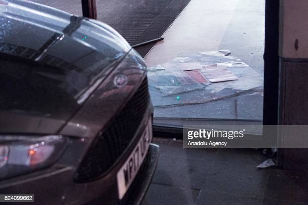 A broken store window is seen following a demonstration demanding justice after the death of Rashan Charles who was killed last weekend after police...