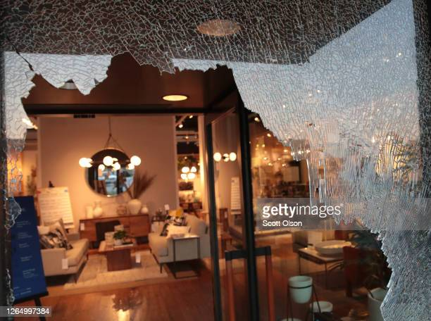 A broken storefront window is seen after parts of the city had widespread looting and vandalism on August 10 2020 in Chicago Illinois Police made...