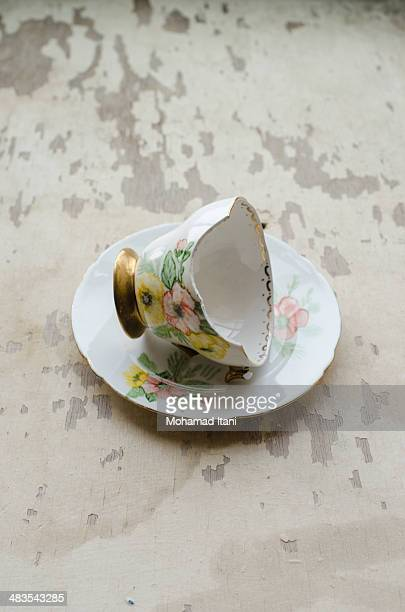 Broken teacup and saucer