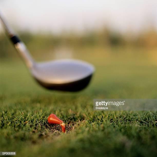 broken tee and golf club - golftee stock-fotos und bilder