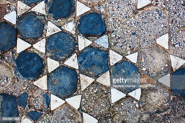 Broken tile in the shape of stars on the ground