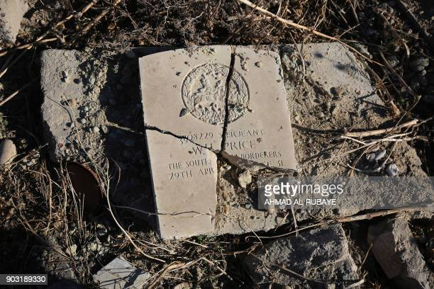 A broken tombstone is seen on January 8 2018 in the British Commonwealth war cemetery of First and Second World War which was destroyed by the...