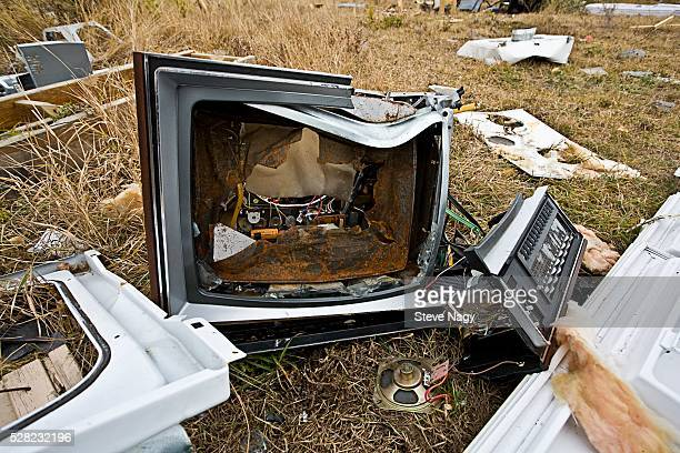 Broken TV and Garbage on Ground