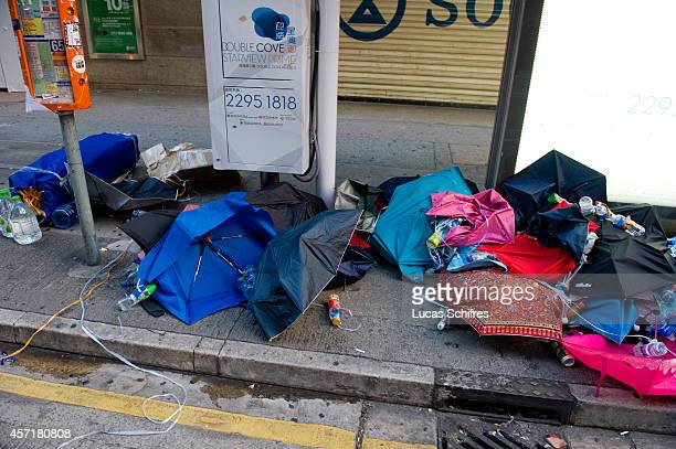 Broken umbrellas are all what's left of an artistic installation of a giant umbrella on Hennessy Road in former 'Occupy Central' camp in Causeway Bay...