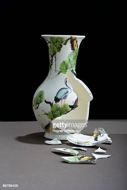 a broken vase - vase stock pictures, royalty-free photos & images
