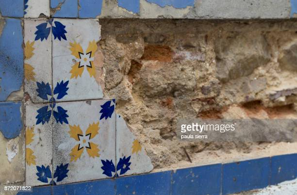 Broken wall with decorative tiles