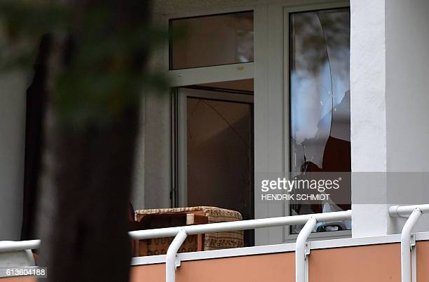 A broken window can be seen at an apartment in the Yorckgebiet district of Chemnitz eastern Germany where German police commandos hunting a fugitive...