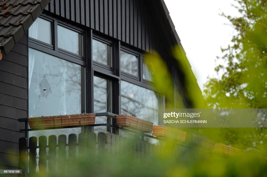 In House Dortmund topshot a broken window is seen at a residential house to
