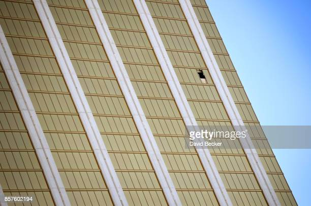 A broken window is seen at the Mandalay Bay Resort Caisno on October 4 2017 in Las Vegas Nevada The Las Vegas hotel was the location where a lone...