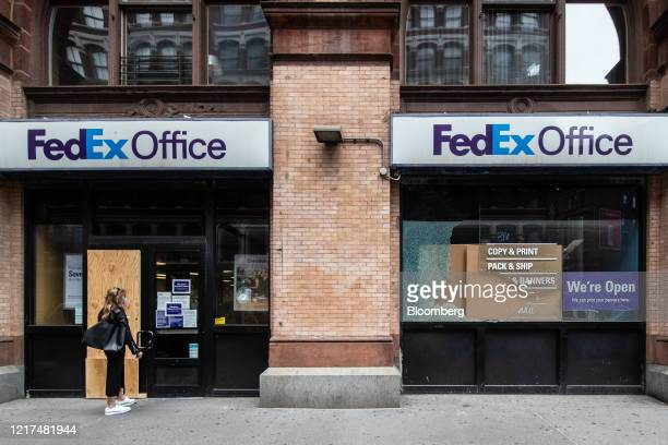 Broken window is seen outside a Fedex Corp. Location after protests in New York, U.S., on Wednesday, June 3, 2020. After months of lockdown,...