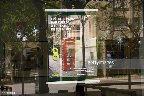 broken window of a bank in spain - bankia stock pictures, royalty-free photos & images