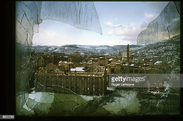Broken window sits in the destroyed parliament building March 5, 1996 in Sarajevo, Bosnia-Herzegovina. The city is reopening its businesses,...
