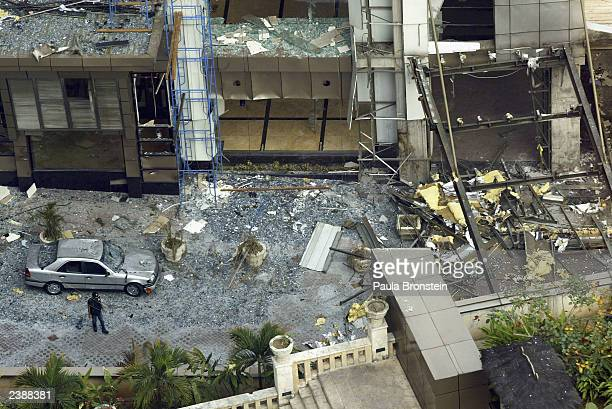 Broken windows and destruction surround Plaza Mutiara building blasted out from the terrorist attack which is adjacent to the JW Marriott Hotel in...