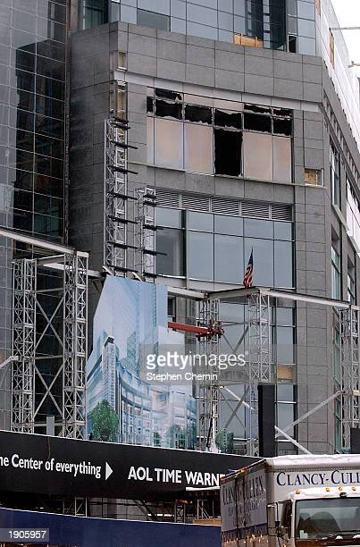 Broken windows are seen on the new AOL Time Warner building under construction April 8, 2003 at Columbus Circle in New York City. A four-alarm fire...