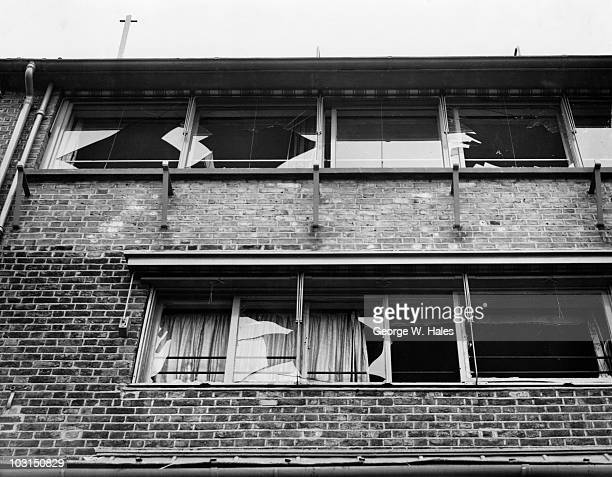 Broken windows in a nearby building after an unsuccessful attempt by the Irish Republican Army to blow up Hammersmith Bridge in west London 29th...