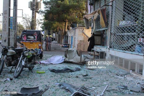 Broken windows of a damaged building is seen after a suicide bomb attack in Afghanistan's western city of Herat on August 9 2018 At least 4 killed...
