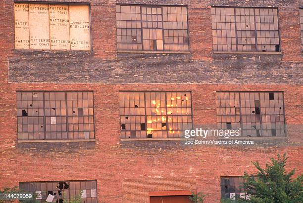 Broken windows of an abandoned brick factory building South Bend Indiana