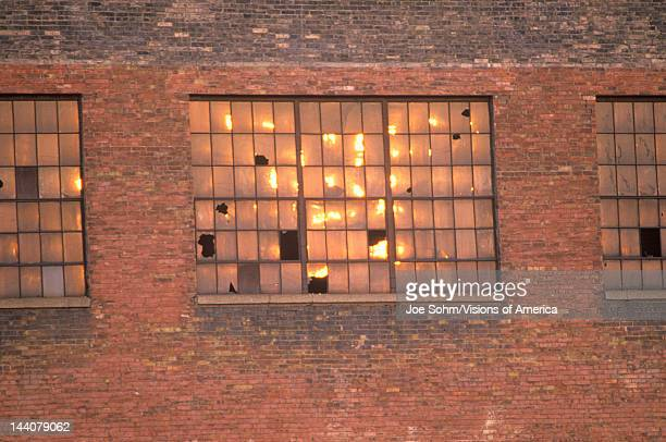 Broken windows of an abandoned brick factory building, South Bend, Indiana